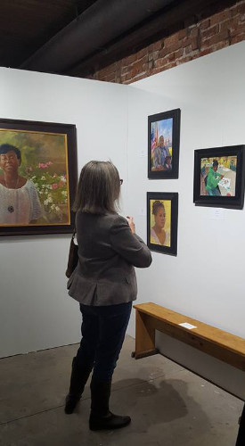 A Woman Admiring the Aplachicola Art